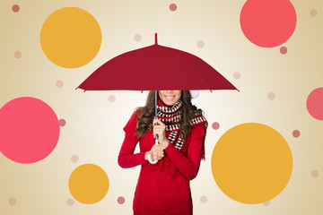 Woman under umbrella smiling