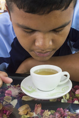 Boy drink hot green tea