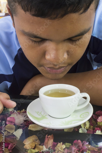 canvas print picture Boy drink hot green tea