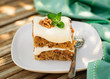 A Piece of Zucchini and Walnut Cake with Cream Cheese Frosting