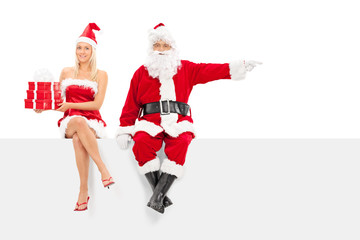 Santa and a girl with presents seated on panel