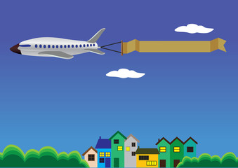 Airplane with banner flying above Houses