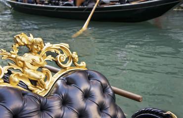 Gondola moored on a venetian canal - Venice, Italy