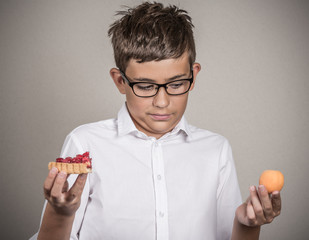 young man with glasses deciding on diet grey background