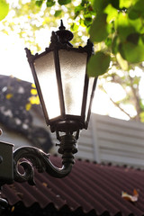 Street lamp and sun beams