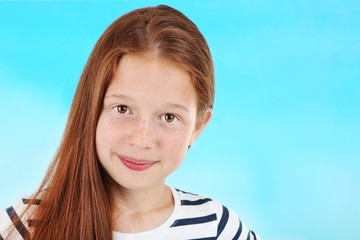 Beautiful little girl on bright background