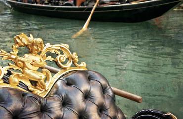 Vintage gondola moored on a venetian canal - Venice, Italy, Euro