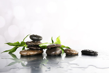 Spa stones, leaves, bamboo branches flooded with water surface