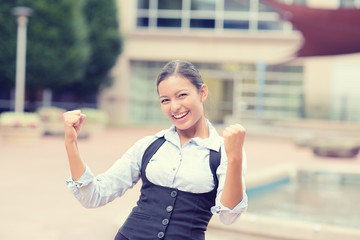 successful young business woman excited celebrates victory