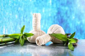 Spa composition with herbal massage bags and bamboo