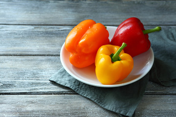 ripe peppers on a white plate