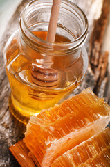 Honey in jar and honeycomb