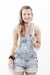 Portrait of young woman in dungarees, smiling