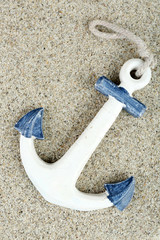 Anchor on sand background