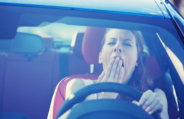 sleepy tired woman driver driving car yawning lack of attention
