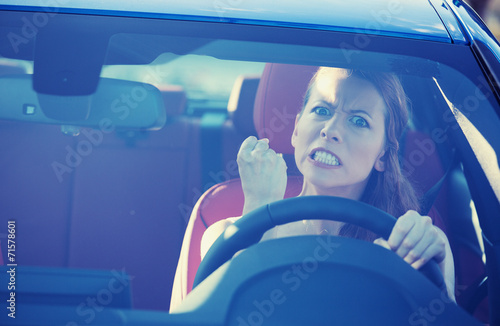 angry aggressive woman driving car screaming