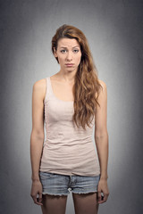 Gave up weak woman standing on grey wall background
