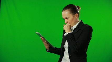 Successful businesswoman with tablet. FULL HD, green screen
