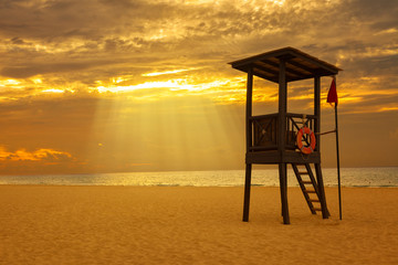 lifeguard hut at sunrise in a Caribbean beach