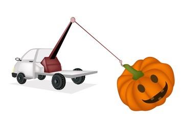 Wrecker Tow Truck Pulling A Jack-o-Lantern Pumpkins