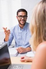 Businessman interviewing woman