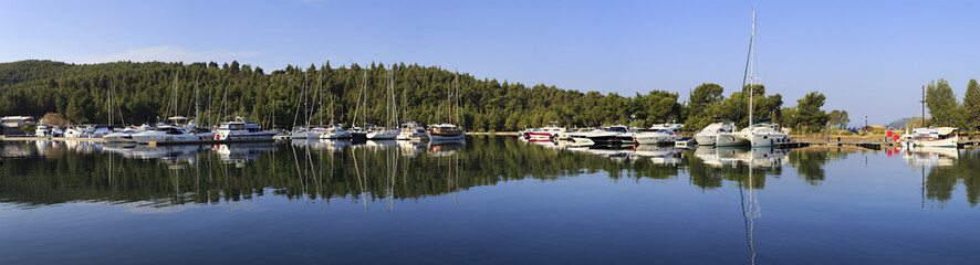 Mirror panorama of yachts and boats.