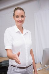 Businesswoman offering handshake at office