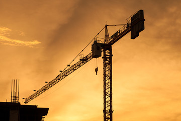 silhouette of building construction on evening