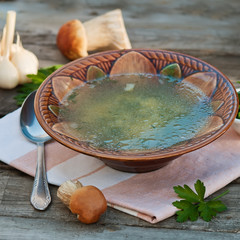 Mushroom soup on the wooden background
