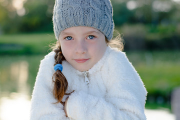 Young girl in cold weather, wearing warm clothes