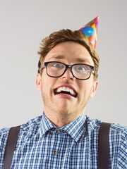 Geeky hipster wearing party hat