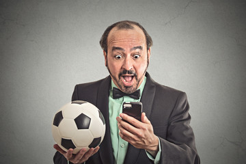 Man watching football game on smartphone excited face expression