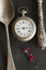 Vintage spoon, knife and pocket watches.