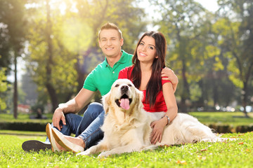 Young couple in park with a dog