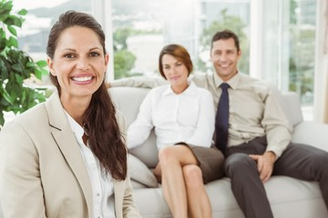 Couple in meeting with a female financial adviser