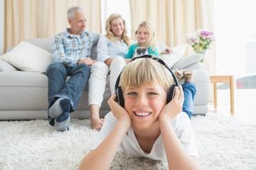 Little boy listening to music on the floor