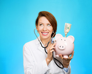 health care professional with piggy bank on blue background