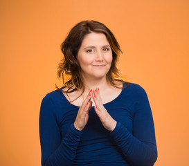 sly scheming woman planning prankster revenge orange background