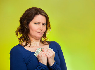 greedy woman holding dollar banknotes on green background