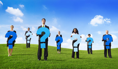 Group of Business People Holding Question Mark