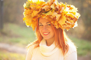 Autumn woman with crown of fall maple leaves