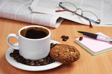 Coffee with cookie, newspaper and note