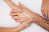 Manicurist washing customers hand poster