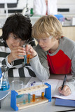 Students performing experiment in school chemistry laboratory