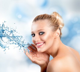 Beautiful  woman with splashes of water