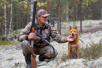 the hunter with his dog