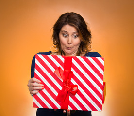 woman opening red gift box, surprised face expression
