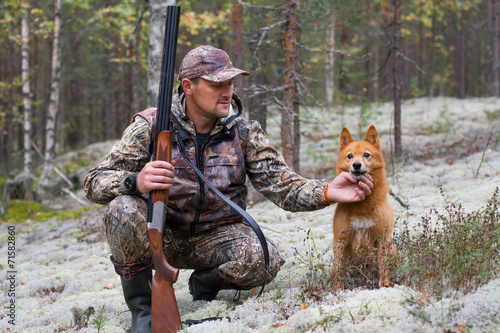 Fotobehang Jacht the hunter with his dog