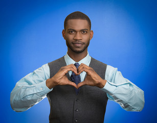business man makes hands shaped like heart blue background