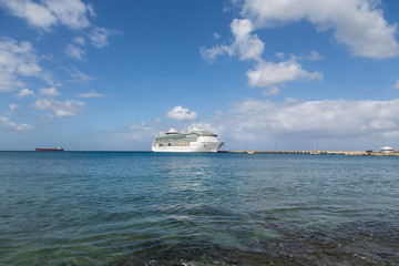 Cruise Ship at End of Pier in Calm Bay